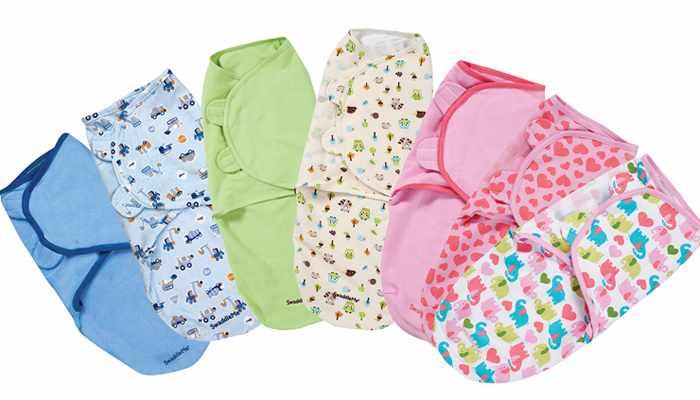 Пеленать с помощью конверта очень просто: достаточно поместить ребенка ножками в карман, а плечики малыша совместить с верхним краем пеленки и зафиксировать липучками - все готово!